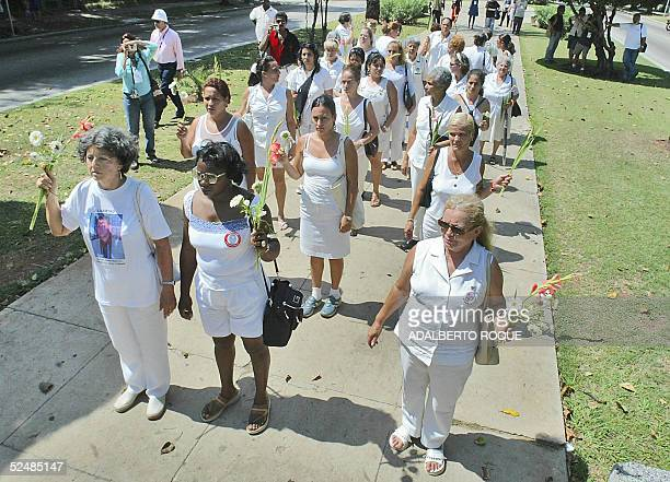 A group of Cuban women wives and daughters of political prisoners who call themseves the 'ladies in white' protest in Havana's 5th Avenue 27 March...
