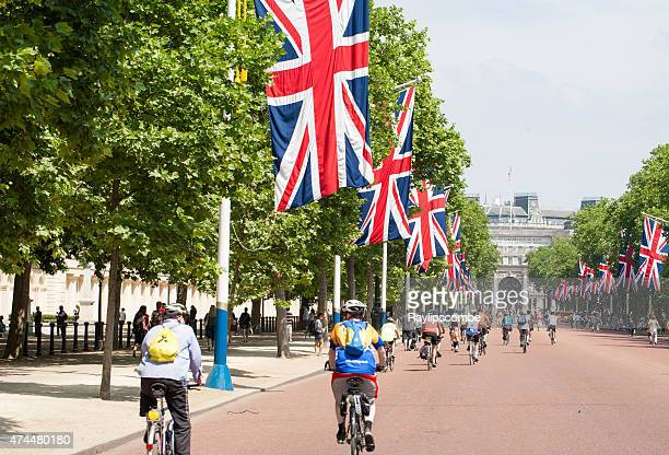 Group of cyclists, cycling down the Mall in London