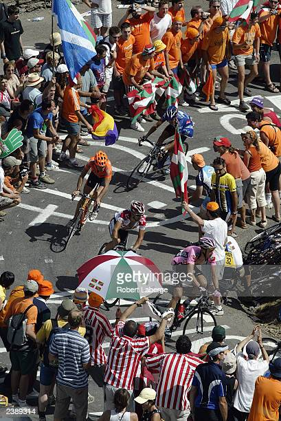 Group of cyclists negotiate the last turn leading up to the Col de Peyresourde during stage fourteen between Saint-Girons and Loudenvielle-Le-Louron,...