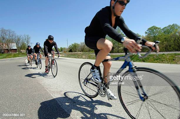 group of cyclists on rural road - bloomington indiana stock pictures, royalty-free photos & images