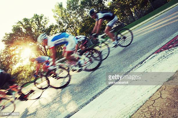 group of cyclists rushing by camera - cycling event stock pictures, royalty-free photos & images
