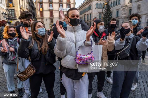 Group of dance students wearing masks as preventive measures against Covid19 clap their hands during a protest in Plaza de Sant. Teachers,...