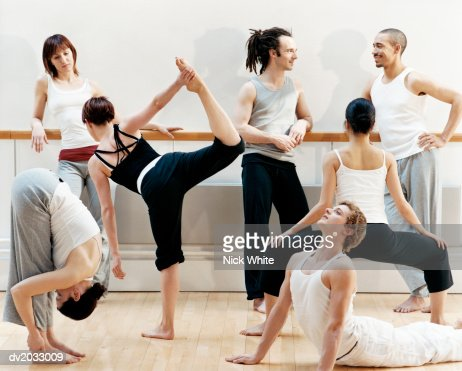 group of dancers doing stretching exercises stock photo