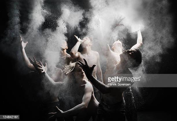 group of dancers with white powder