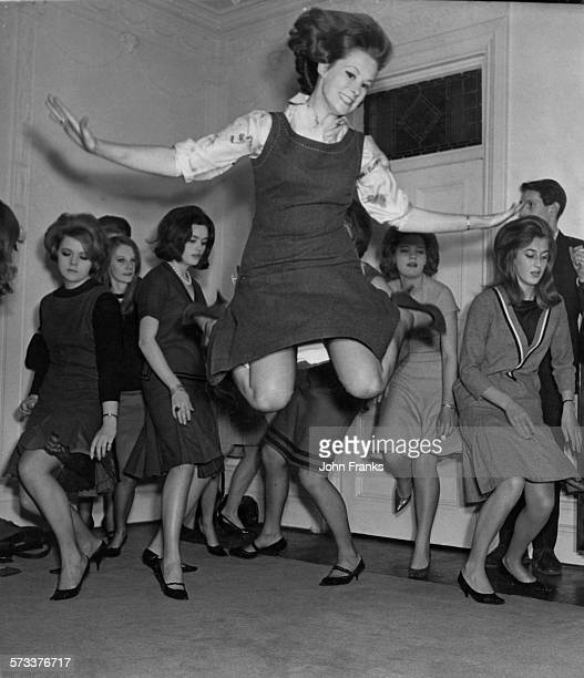 A group of debutantes rehearsing a twist dance routine for 'Take To The Hills' a charity revue which is due to open in a week at the Scala theatre in...