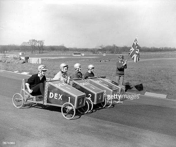 Susan Hampshire Gloria Kindersley Rosalind Watkins Amanda Legge and holding the flag Lady Mary Rous in soap box trolleys practising for the Easter...