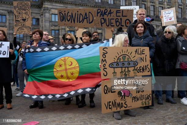 A group of demonstrators carry a Mapuche flag during the demonstration organized today in Amsterdam in support of the Chilean protesters on October...