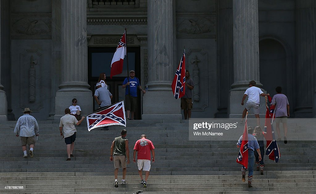 A group of demonstrators climbs the steps of the South Carolina State House calling for the Confederate flag to remain on the State House grounds June 27, 2015 in Columbia, South Carolina. Earlier in the week South Carolina Gov. Nikki Haley expressed support for removing the Confederate flag from the State House grounds in the wake of the nine murders at Mother Emanuel A.M.E. Church in Charleston, South Carolina.