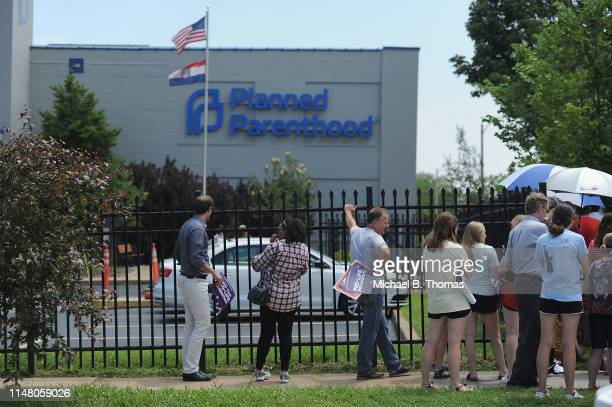 A group of demonstrators gather during a prolife rally outside the Planned Parenthood Reproductive Health Center on June 4 2019 in St Louis Missouri...