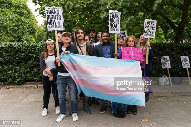 A group of demonstrators gather in front of the US Embassy to protest against Donald Trump's latest announcement that transgender troops will not be...