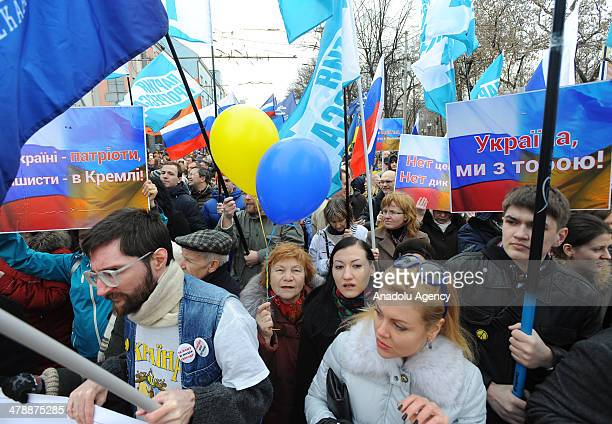 A group of demonstrators march from Puskin square to Saharova square in Moscow during a protest against the Crimea's independence referendum...