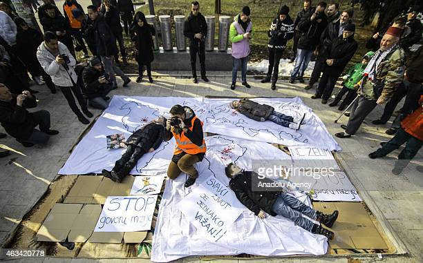 A group of demonstrators protest against the Chapel Hill shooting in Sarajevo Bosnia and Herzegovina on February 14 2015 Three young Muslim Students...