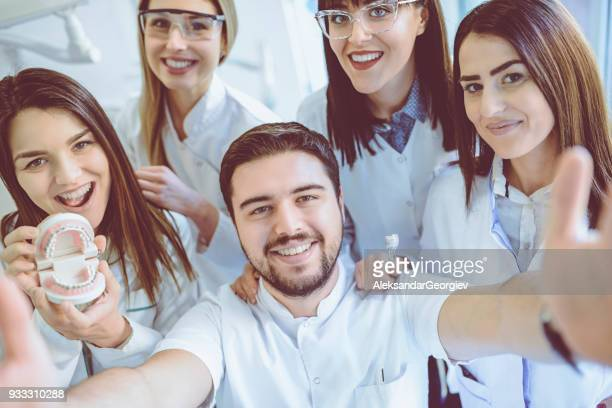 Group of Dentists Students Make Selfie in Clinic