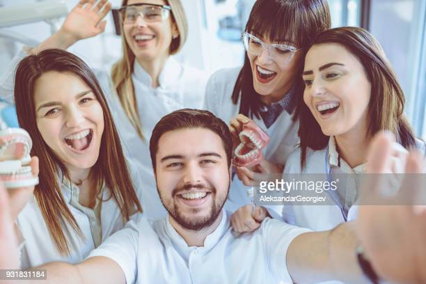 Group of Dentists Students Make Selfie with Dentures and Braces in Clinic
