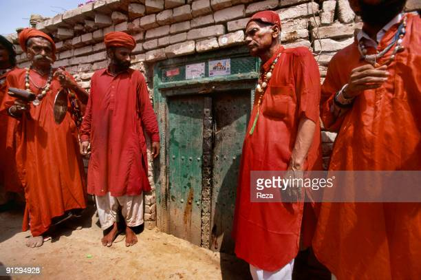 A group of dervishes waiting to greet their sufi master Sheikh Akhtar Hussein Pirzada titled as Noor Ali Shah at the entrance of a special room where...