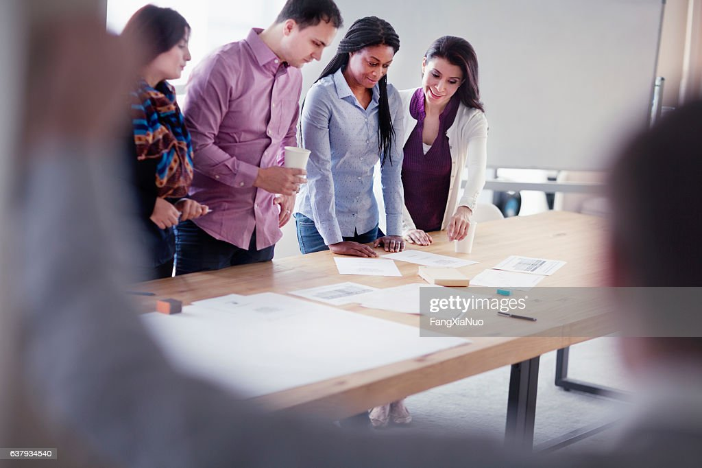 Group of designers collaborating in office studio : Stock Photo