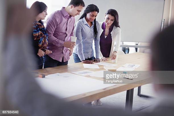 group of designers collaborating in office studio - attending stock pictures, royalty-free photos & images