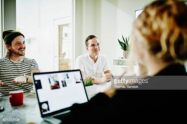 Group of designers in discussion during meeting