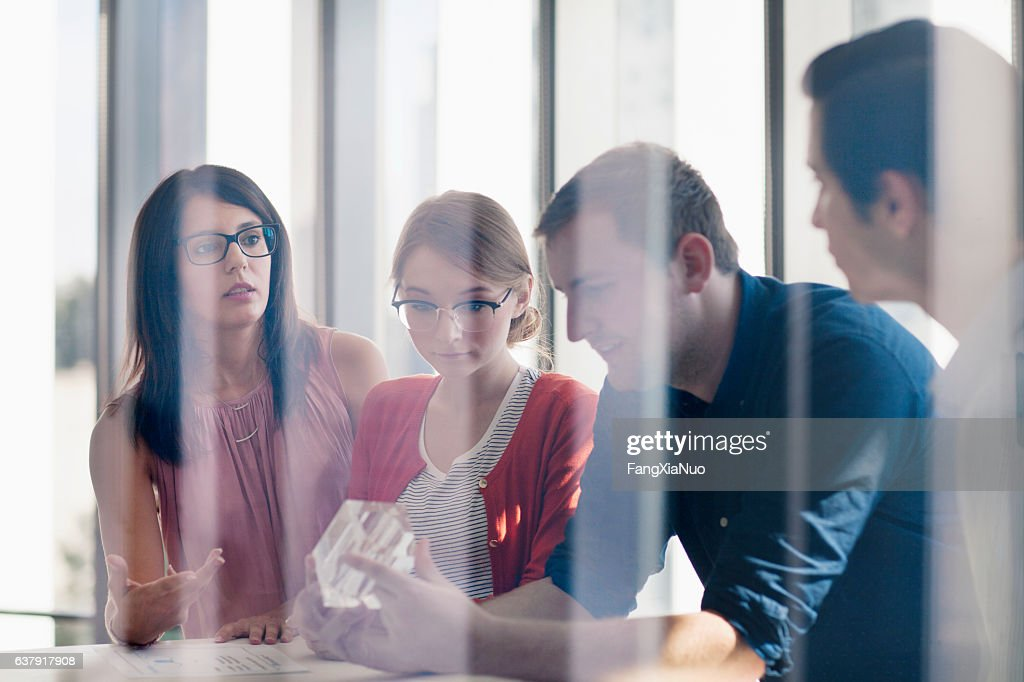 Group of designers planning together in studio : Stock Photo