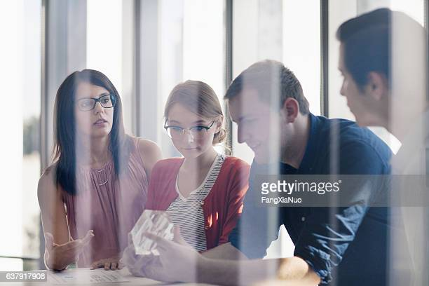 group of designers planning together in studio - copyright stock photos and pictures