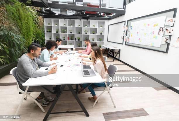 Group of designers working in a meeting at a co-working space
