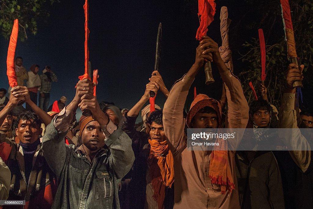 men posing with knives at gadhimai