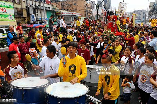 A group of devotees of Black Nazarene danced to the beet of a mardigra music during the Replica prepossession blessing in front of Quiapo church in...