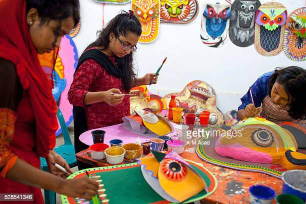 CHARUKOLA DHAKA DHAKA BANGLADESH A group of Dhaka University Art Institute student paint masks for colorful preparation to celebrate upcoming Bengali...
