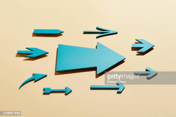a group of different arrows moving forward together - richard drury stock pictures, royalty-free photos & images