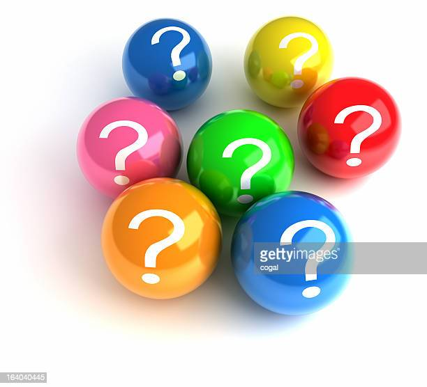 Group of different colored balls with a question mark on all