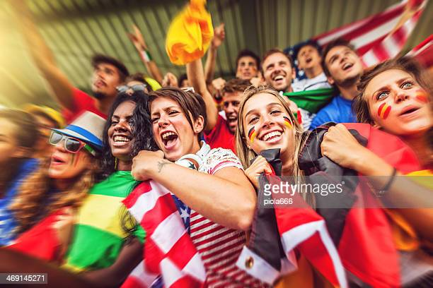 Group of different nations supporters together