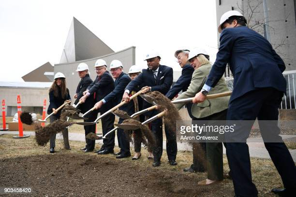 A group of dignitaries break ground during the groundbreaking ceremony for the north addition to the Denver Art Museum on Wednesday January 10 2018