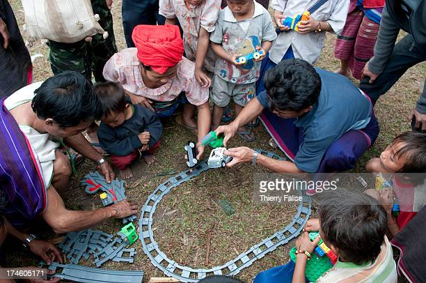 A group of displaced Karen people play with a Lego train distributed by the relief group Free Burma Rangers The Danish company Lego has given more...