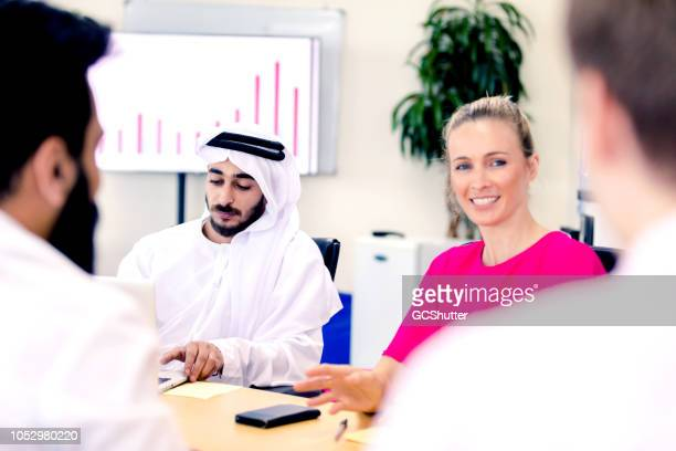 group of diverse business executives having a discussion - shareholder's meeting stock photos and pictures