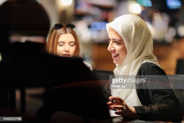 group of diverse business people having business meeting in cafe - islam stock pictures, royalty-free photos & images