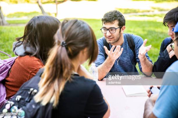 Group of Diverse College Students Around the Table