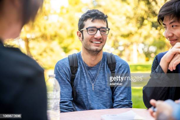 group of diverse college students around the table - philosophy stock pictures, royalty-free photos & images