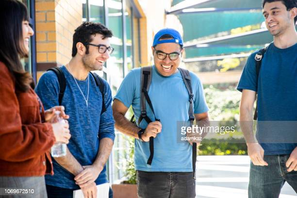 Group of Diverse College Students Walking on Campus