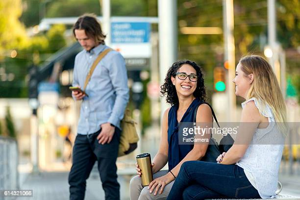Group of diverse commuters waiting for public transit