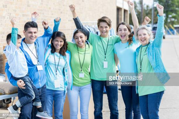 group of diverse people volunteer at charity event - non profit organization stock pictures, royalty-free photos & images