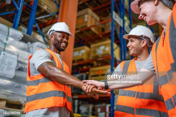 group of diversity warehouse worker meeting and checking list inventory in industry factory . eastern manager, african american clerk clipboard , asian man using tablet . teamwork of multiethnic - workers compensation stock pictures, royalty-free photos & images