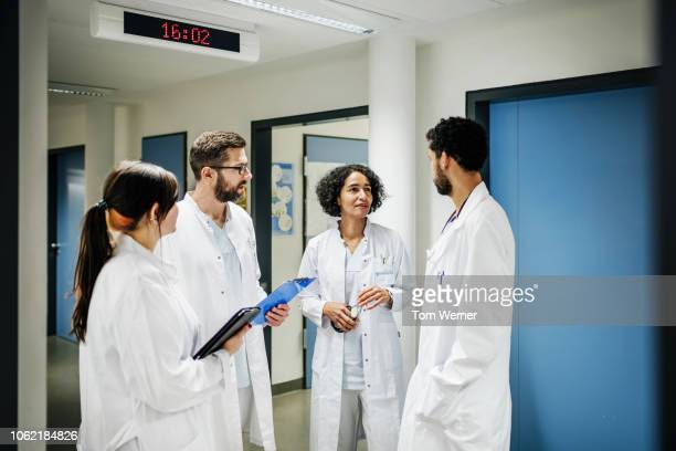 group of doctor chatting on the ward - group of doctors stock pictures, royalty-free photos & images