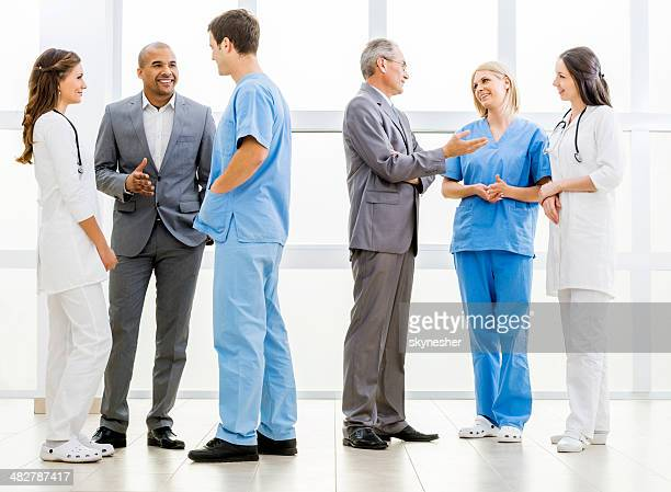 Group of doctors and business people talking.