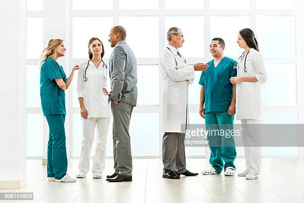 Group of doctors and businessman talking.