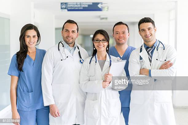 group of doctors at the hospital - group of doctors stock pictures, royalty-free photos & images