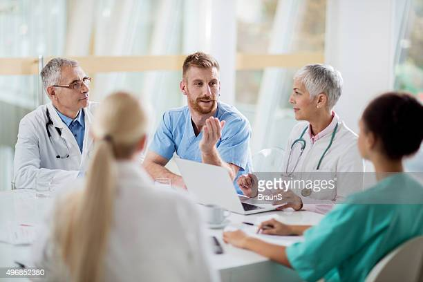 Group of doctors communicating on a meeting in the hospital.