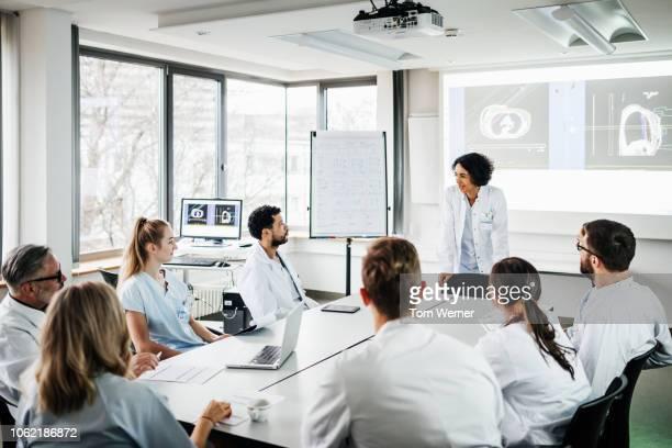 group of doctors listening to presentation - 数人 ストックフォトと画像