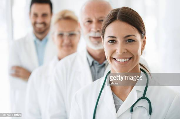 group of doctors looking at the camera. - doctor stock pictures, royalty-free photos & images
