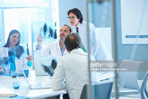 Group of doctors looking at x-rays