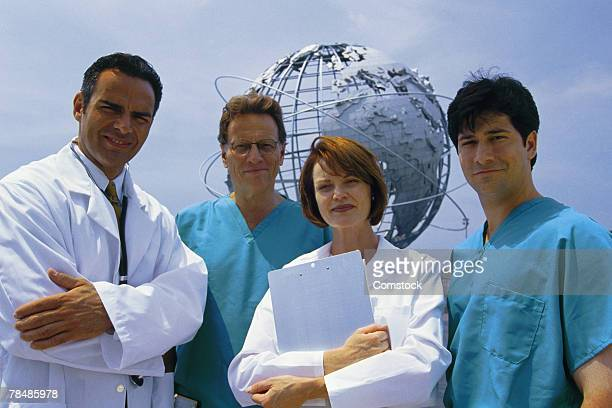 Group of doctors outdoor with globe